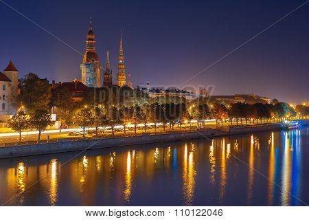 Old Town of Riga and River Daugava at night, Riga Cathedral and Saint Peter church, Railway Bridge and Riga Radio and TV Tower in the background, Latvia poster