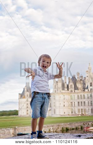 Cute Boy, Having Fun Summertime In Front Of Chambord Chateaux