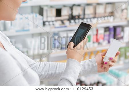 Close up a woman taking picture of product in drugstore