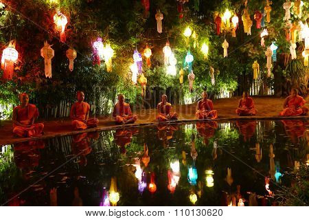 Monk Meditate Beside The Pond Among The Colorful Paper Lantern In Yeepeng Festival