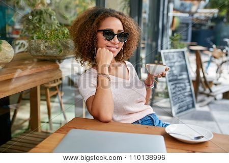 Beautiful Girl Having A Cup Of Coffee At Cafe