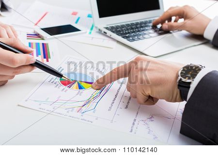 Businessmen working with charts, buisness process, analytics