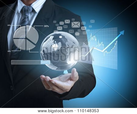 businessman with financial symbols coming from han