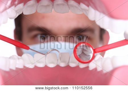 Dentist Working Inside a Patient Mouth