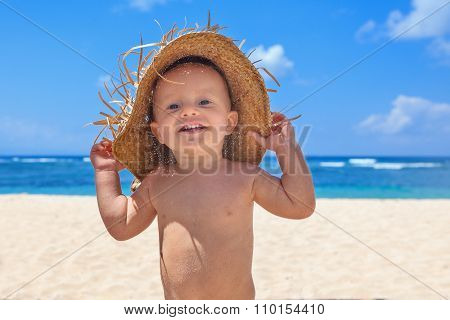 Smiley Child With Hat Has Fun On Sea Sand Beach