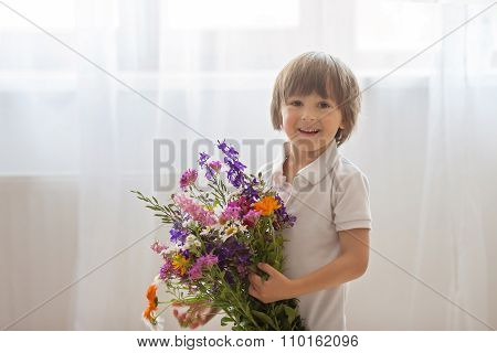 Sweet Little Boy, Holding Big Bouquet Of Wild Flowers For Mom