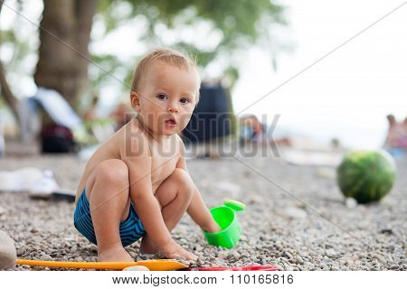 Little Baby Boy On The Beach, Playing