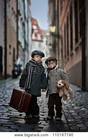 Two Adorable Boy, Dressed In Vintage Style In The City Center