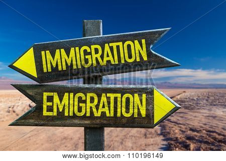 Immigration - Emigration signpost in a desert background