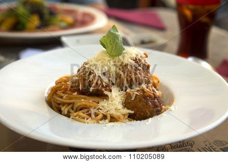 Meat balls with bolognese spaghetti sauce in a white plate