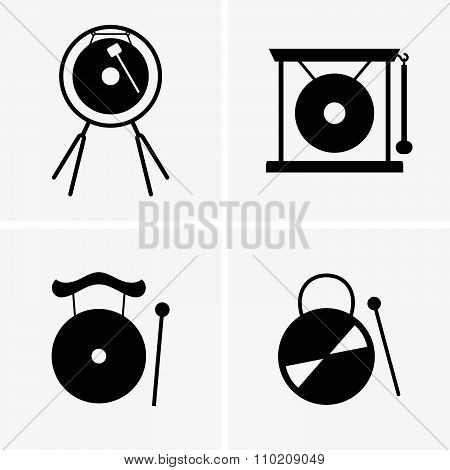 Set of four gongs and sticks (shade pictures) poster