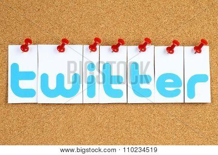 Twitter logotype printed on paper