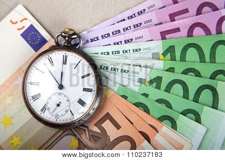 Time And Money Concept Image. Euro Banknotes With Vintage Watch