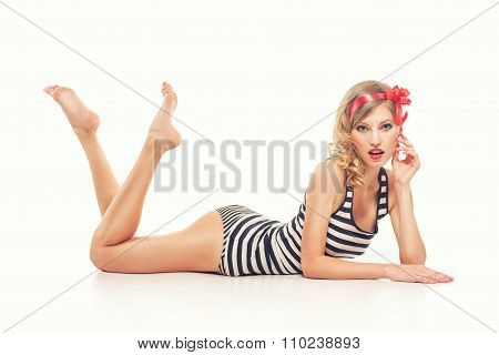 Pinup young woman in vintage swimsuit