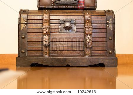 Antique trunk coated with iron and leather
