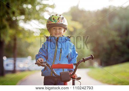 Cute Little Boy, Toddler Child, Riding Bike In A Helmet