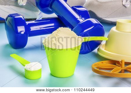 Scoops with whey protein and creatine