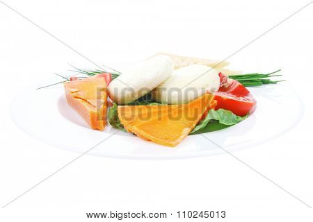 old blue stilton roquefort with orange cheddar and yellow parmesan and soft feta cheese on plate with isolated over white background