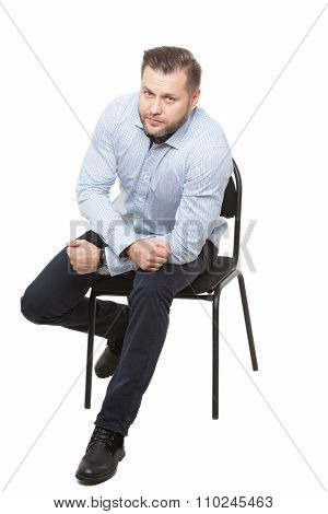 man sitting on chair. Isolated white background. Body language. gesture of readiness for action. sta