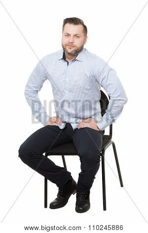 man sitting on chair. Isolated white background. Body language. expectations and readiness posture.