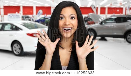 Happy client woman near cars. Auto dealership and rental concept background.