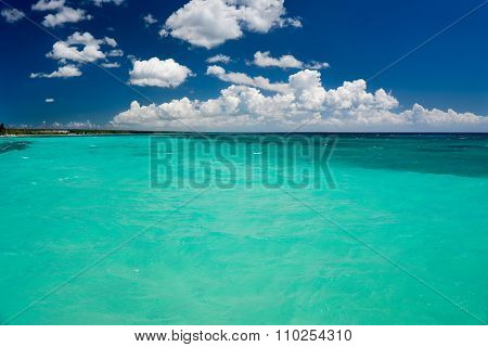 Tropical Sea With Turquoise Water, Blue Sky And White Clouds