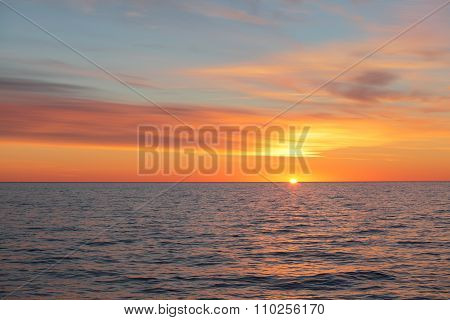 Early Morning Sun Rising From The Sea