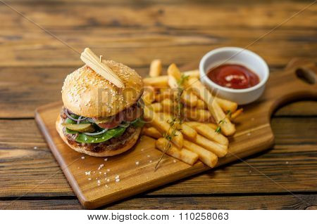 Home made burgers on wooden background
