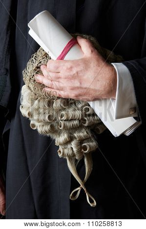 Close Up Of Barrister Holding Brief And Wig