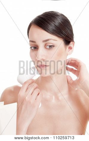 Woman with brush for deep cleansing facial. Skin care concept. High technology beauty. poster