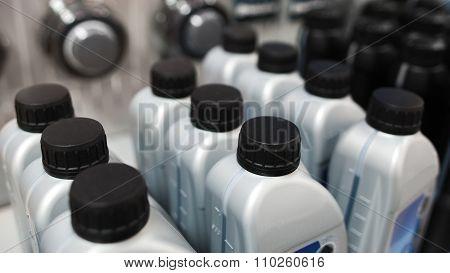 Motor Oil In Plastic Bottle. Store Showcases