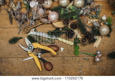 Top Down View Of Florist's Worktable. Making Christmas Decor.