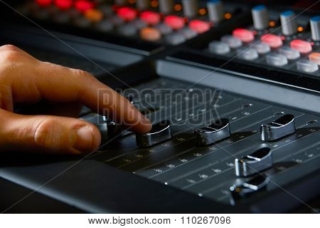 Close Up Of Recording Engineer Pushing Fader In Studio