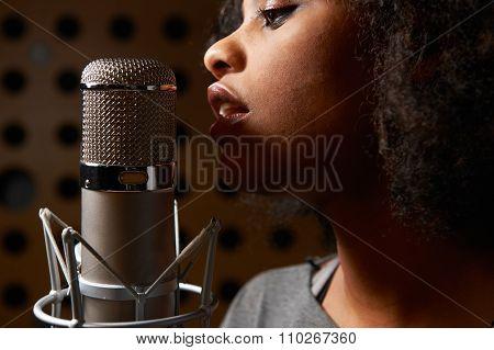 Female Vocalist In Recording Studio