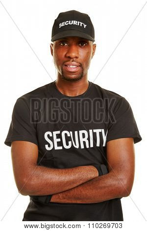 Smiling black man as security guard with his arms crossed