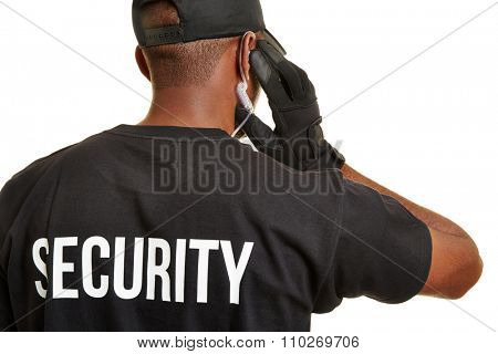 Black man as security guard from behind