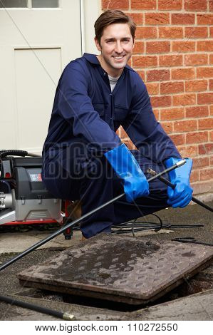 Portrait Of Plumber Fixing Problem With Drains poster