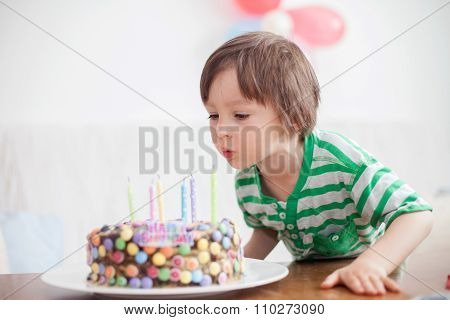 Beautiful Adorable Four Year Old Boy In Green Shirt, Celebrating His Birthday