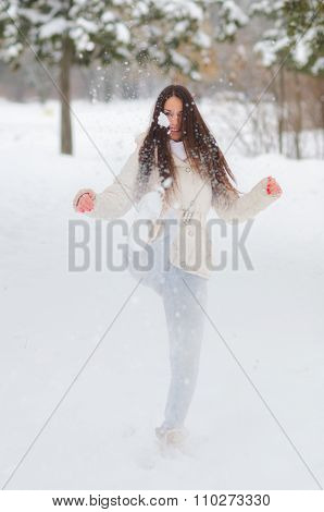 Happy Girl Kicking Snow On Beautiful Winter Day