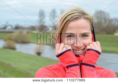 Blond Woman Standing On The Dike