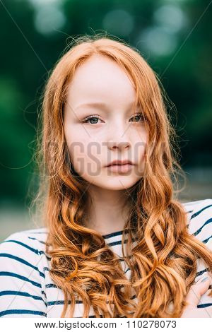 A Beautiful Girl With Green Eyes And Long Curly Red Hair In Summer Park. Outdoor Portrait Of A Red-h
