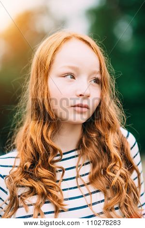 An Adorable Teenage Girl With Long Curly Ginger Hair And Green Eyes In Summer Park. Outdoor Portrait