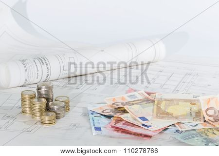 architectural plans, banknotes and coins