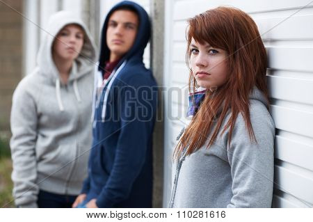 Gang Of Teenagers Hanging Out In Urban Environment