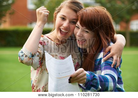 Teenage Girls Celebrating Good Exam Result