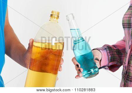 Studio Shot Of Teenage Couple Drinking Alcohol