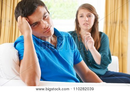 Teenage Couple Having Arguement At Home
