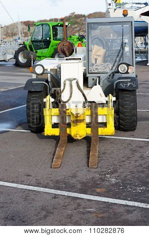 Two Forklift Standing In The Harbour