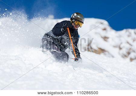 Skier Skiing On Ski Slope