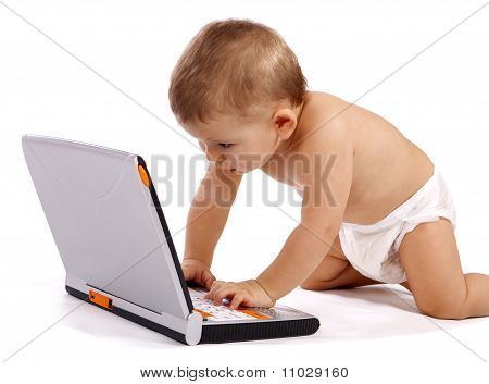 little baby with computer